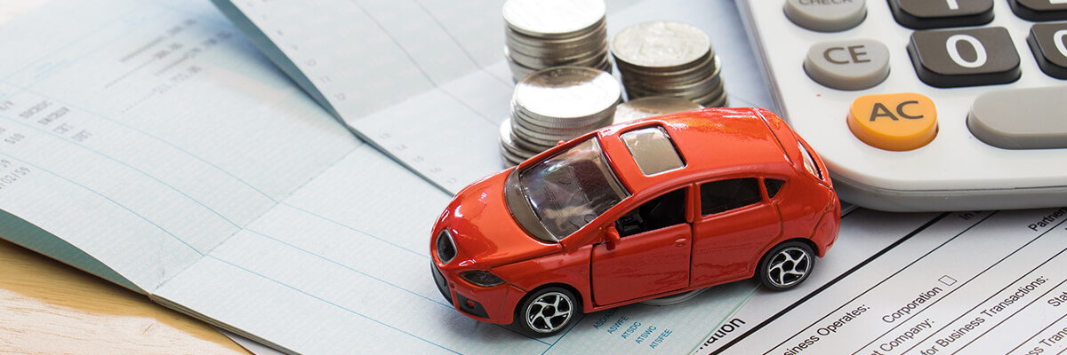toy car on insurance papers